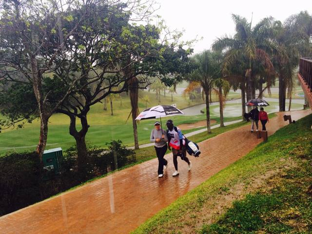 players leaving the course